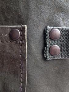detail-zakafwerking-schort legertentstof